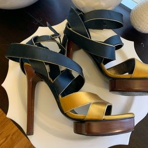Lanvin gold and black satin platform sandal.
